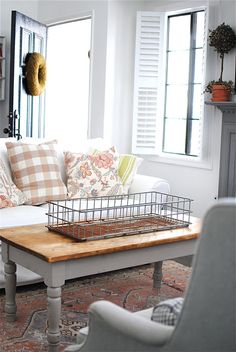 I'm in LOVE with that basket on the coffee table! - love the shutters on the window too
