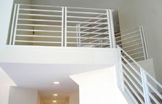 A custom designed flat bar metal railing system for a residential property.