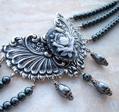 Grey Pearl Choker Rose Cameo Goth Jewelry Gothic Victorian Choker. about $148.75, via Etsy.