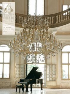 I would like to practice my piano pieces in THIS room!  Especially if it looked onto a beautiful lake!  [Masiero chandelier, gorgeous cream, taupe, crystals and black.]