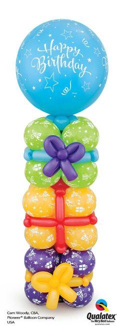 Columna de globos con aspecto de cajas de regalo, me encanta. #DecoracionGlobos: