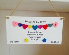 Personalised Handmade Mother Of The Groom Plaques.  These bespoke plaques are carefully handmade to order. They are 10cm X 20cm in size. They are made of MDF wood and hand painted white in colour to give a rustic effect. These plaques are hand worded using a choice of Black or Silver lettering. They read Mother Of The Groom at the top and the main text reads today a groom, tomorrow a husband, forever your son . The plaques are also Personalised with the Grooms Name & Wedding Date.  The Pl...