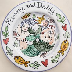 Hand painted personalised mermaid and Neptune Mummy and Daddy gift plates by Kate Glanville.