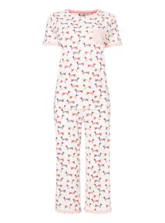 Cute and playful, this pure cotton pyjama set is a fun addition to your nightwear collection. Featuring a sausage dog print and finished with polka dot frill detailing, these cropped pjs will brighten up your bedtimes. Cream sausage dog crop pyjama set Rounded neck Pure cotton Cropped trouser Sausage dog print Frills Polka dot finish Model's height is 5'11'' Model wears a size 12