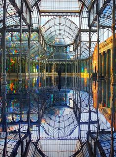 Artist Kimsooja transformed the Palacio de Cristal into a heavenly dreamworld using translucent diffraction film on the windows to create a rainbow effect which reflected off the mirrored floor. Architecture Design, Cultural Architecture, Futuristic Architecture, Bangkok Travel Guide, Best Honeymoon Destinations, Cities In Italy, Morocco Travel, Le Palais, Visit Italy