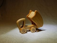 A wooden truck Dumper with a body for transportation toys Waldorf toy for boy 14 cm x 9 cm x 7 cm wood birch and maple covered with linseed oil Handmade Wooden, Handmade Toys, Hybrids And Electric Cars, Eco Friendly Cars, Wooden Truck, Push Toys, Garbage Truck, Waldorf Toys, Car Makes