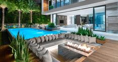 A Sunken Lounge Around A Fire Is A Great Way To Create A Relaxed Outdoor Vibe Choeff Levy Fischman has designed a modern house in Miami Florida and as part of the design they included an nbsp hellip Living Pool, Outdoor Living Rooms, Backyard Pool Designs, Swimming Pools Backyard, Outdoor Fire, Outdoor Lounge, Outdoor Pool Areas, Sunken Fire Pits, Infinity Edge Pool