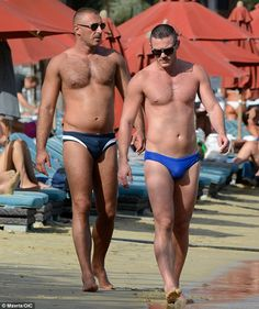 Hunks in trunks: Luke Evans was given the perfect opportunity to show off his chiselled frame as he hit the beach on the beautiful Greek island of Mykonos with a male companion on Sunday