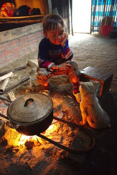 Homestay in Hmong family in the mountains near Sa Pa (north of Vietnam). He was steaming rice for dinner.