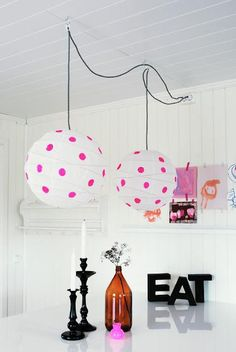 Paint your favorite dot color on white lanterns: http://www.partylights.com/Lanterns/White