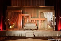 indian wedding reception stage gold loveseat http://maharaniweddings.com/gallery/photo/12481
