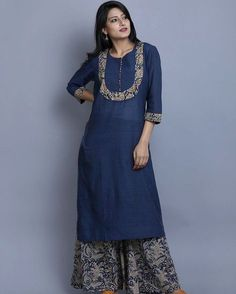 """A simplistic Khadi kurta detailed with Kalamkari and paired with an indigo mul Kalamkari palazzo. Salwar Neck Designs, Churidar Designs, Neck Designs For Suits, Kurta Neck Design, Kurta Designs Women, Dress Neck Designs, Blouse Designs, Kurta Patterns, Dress Patterns"
