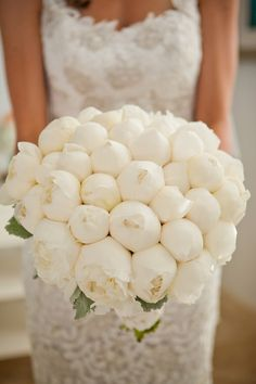 Bouquet of 3 dozen lush white peonies! | Read More: http://www.stylemepretty.com/little-black-book-blog/2014/06/30/romantic-turks-caicos-beach-wedding/ | Photography: Dave Robbins Photography - daverobbinsphotography.com