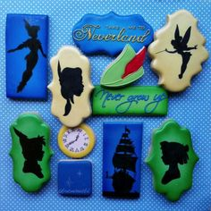 These Awesome Peter Pan Cookies were made by Frost Me Beautiful. These Peter Pan cookies feature a Tick-Tock the Crocodile cookie, some Tinker Bell cookie, a lost boy cookie, a Wendy Cookie, and a Tiger Lily cookie. There is a red Captain Hook cookie. These Peter Pan cookies features some...