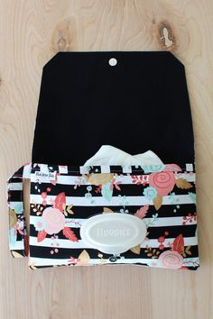 This diaper clutch is perfect for those quick outings with baby. Grab it and go! Throw in into your diaper bag to stay organized, and pull it out for a quick stop with baby. It works great as a small diaper bag for toddlers when they dont need much more than diapers and wipes. It is handmade from black and white stripe fabric with a coral, mint and metallic gold floral print. It is lined with solid black fabric.  It fits the following wipes, Pampers or Huggies wipes 64 ct. or smaller. The…