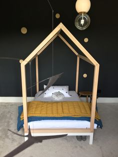Love this creative kids room with a house bed - see more at http://www.oddsockoddshoe.co.uk/