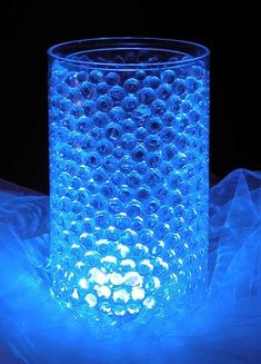Centerpiece idea using waterbeads and LED lights - This is SUCH an inexpensive way to make a WOW centerpiece! You can use lots of different colors of the Jelly Decor or different colors of the submersible LED Floralytes. This is one of the hottest tabletop trends around.