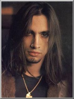 Nuno Bettencourt (Extreme) Never like the band extreme but, I think Nuno was a good guitarist and he's hot as hell.lol