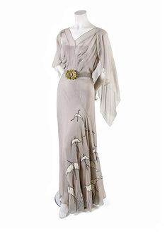 A French Couture Pale Blue Day Dress, probably 1920s, bias cut with bird appliques along skirt, attached belt with art deco style clasp, low back, matching slip.