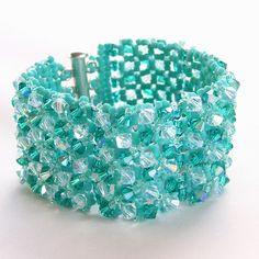 https://www.bkgjewelry.com/ruby-rings/165-18k-yellow-gold-diamond-ruby-heart-ring.html beaded cuff