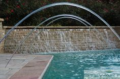 Don't forget to keep the pool fun with water features! #StewartLandDesigns