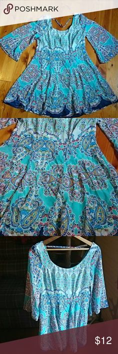 AS  U Wish tunic Colors are background an aqua green colors.. There is blue. Purple olive and red..I do not have professional lighting so reflections may appear.. In good shape  measurements pit to pit layed flat 16 1/2 waist 15 1/2 shoulder to bottom 31.. Flowy sleeves As U Wish Tops Tunics