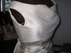 Bodice shot of the vintage-inspired wedding gown. The fit on the mannequin caused the wrinkle over the bust.