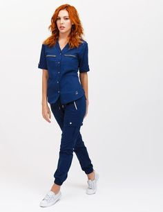 The Jogger Pant in Estate Navy Blue is a contemporary addition to women's medical scrub outfits. Shop Jaanuu for scrubs, lab coats and other medical apparel. Scrubs Outfit, Scrubs Uniform, Medical Scrubs, Nursing Scrubs, Nursing Tips, Jogger Pants, Joggers, Stylish Scrubs, Medical Uniforms