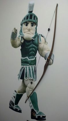 Michigan State University mascot Sparty tries archery!