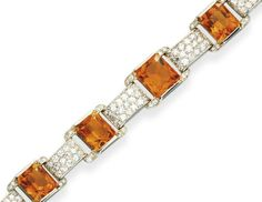 AN ART DECO CITRINE AND DIAMOND BRACELET, BY CARTIER   Designed as a graduated series of cushion-cut citrine and single-cut diamond openwork panels, joined by single-cut diamond rectangular links, mounted in platinum, circa 1930, 7¼ ins., with French assay marks  Signed Cartier, Paris, no. 8781