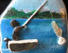 pebble art pebbleart painted rock stone fishing water ocean fish boat sea shell