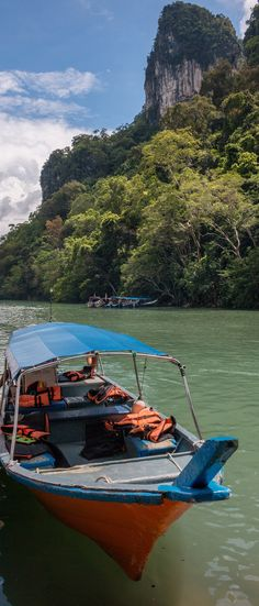 Island Hopping, Langkawi: This Tour Will Get You… A) Pregnant, B) Wet, C) All Of The Above?  | Langkawi, Malaysia is made up of over 99 islands so it makes sense to explore it via boat. Join us as we visit a remote island beach, watch graceful eagles, and swim in a mysterious freshwater lake.