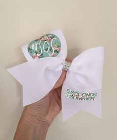 5SOS Flower Pattern White Cheer Bow by TalkToTheBow on Etsy https://www.etsy.com/listing/211053185/5sos-flower-pattern-white-cheer-bow