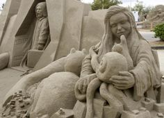 """""""the Alpine Sculptors"""" created by a team from Switzerland, is on display at the World Champion Sand Sculpture Championships held in Federal Way, Washington on October 2, 2010. The team consisting of Jeroen Van de Vlag, Ludo Roders, Antti Pedrozo, Miall Magee and Anique Kuizenga joined 63 sculptors from master sand sculptors from 17 nations that competed to create works of art out of nothing more than sand and water."""