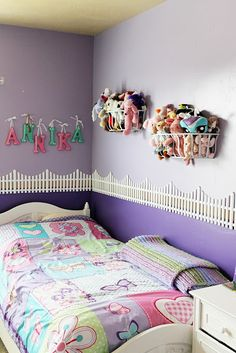 Stuffed Animals Storage in Metal Wall Planters and I love the fence divider between two colors in the room!!!