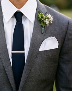 Dark grey suit, white shirt and navy tie for sharp looking groomsmen