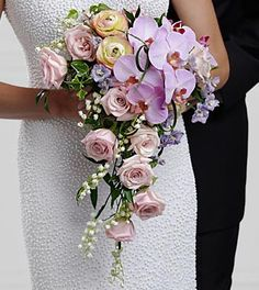 The FTD® True Love™ Bouquet is full of romantic sentiment and dreams for the years ahead. Pink roses, pink ranunculus, lavender larkspur, lavender phalaenopsis orchids, Lily of the Valley, variegated