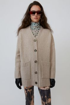 Acne Studios cold beige cardigan is shaped for an oversized fit and finished with ribbed trims and a side-slit hem. Knit Cardigan Pattern, Beige Cardigan, V Neck Cardigan, Acne Studios, Tommy Ton, Marketing Direct, Miroslava Duma, Fashion 2020, Fashion Weeks