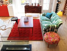 I love the fearless bright colors. Just imagine it with creamy light green walls and an ikat sofa. Yummmm.