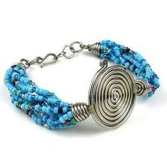 Fair Trade Single Spiral 'Progress' Blue Beaded Bracelet handmade in Kenya by Zakali Creations at Alternatives Global Marketplace Beaded Bracelet Patterns, Jewelry Patterns, Beaded Jewelry, Beaded Bracelets, Jewelry Ideas, Handmade Bracelets, Handcrafted Jewelry, Fashion Bracelets, Fashion Jewelry