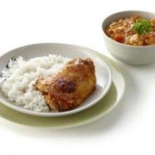 Cajun-kipkarbonade met tomaten-maïssaus en rijst