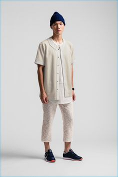 Danny Lim pictured in cropped pants with a longline shirt and baseball shirt.