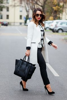 Black and white outfit. Long jacket coat with celine bag