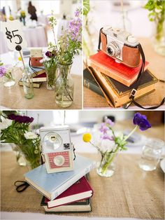 centerpieces with vintage cameras and books