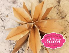 Brown Paper Bag Star Tutorial(do same except don't cut of ends of bags, then put tape on top bag, open up and glue it to bottom bag)-on Creative Ideas FB page under Paper Bags Star