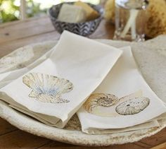 I recently purchased ($14) and these are great for the bathroom, they add a great pop of seashore to your bathroom when draped over white hand towels. <3