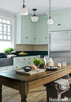 """Don't forget about your kitchen — it could use some color, too. """"In this kitchen project, we painted the cabinets Farrow & Ball's Theresa's Green — a green with a hint of blue which is a color the client always loved and wanted to try,"""" Huh says. """"It infused the kitchen with stylish warmth."""" - ELLEDecor.com"""
