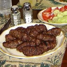 Romanian Grilled Minced Meat Rolls (MICI) are great when grilled, but you could roast or pan-fry. Serve hot with good Italian bread and mustard accompanied by a cold beer. It is great for backyard parties. My friends just love it !