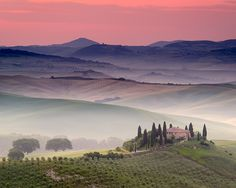 Belvedere villa with mist at dawn, in San Quirico d'Orcia, Tuscany.