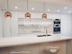 Modern Scandinavian Kitchen. High gloss cabinets, quartz counter, rose gold accents